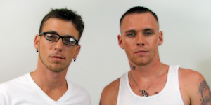 Two new models, a sexy geek and a strong, silent type, get together in this dual jerk off scene.