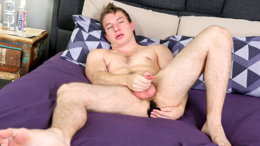 Miles plays with himself while he shoves a couple toys up his tight ass, pulling on his hard cock until 