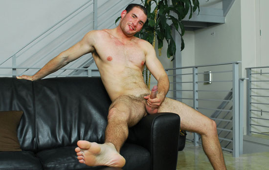 Eric Rollins is a muscular 23 year old stud.  From his beautiful pecs to his big uncut cock, Eric is sexy 
