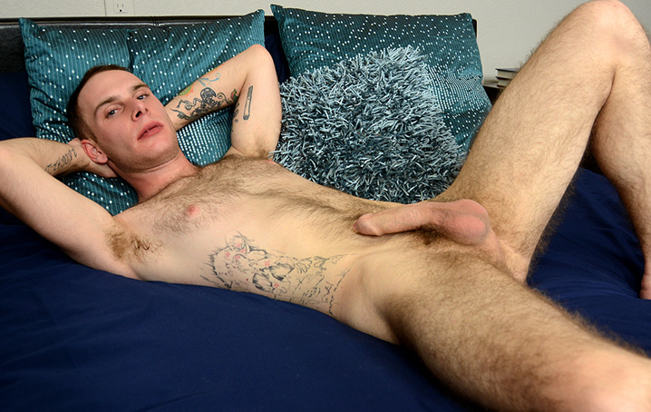Dallas Carson is a graphic arts student who loves tattoos, comics, and getting kinky.  Dallas has a lot  of sexy body hair, which he says is from his Czech heritage.  His secret weapon, though, is his very  nice thick uncut dick!  After he strips down, he plays with his semi-fl